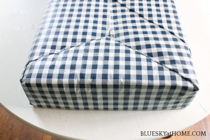 fabric pinned to no~sew bench cushion