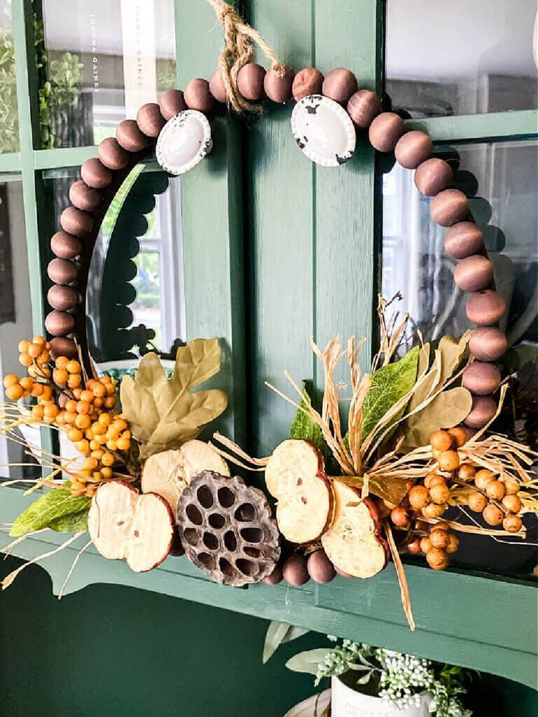 fall wreath with beds and fall florals