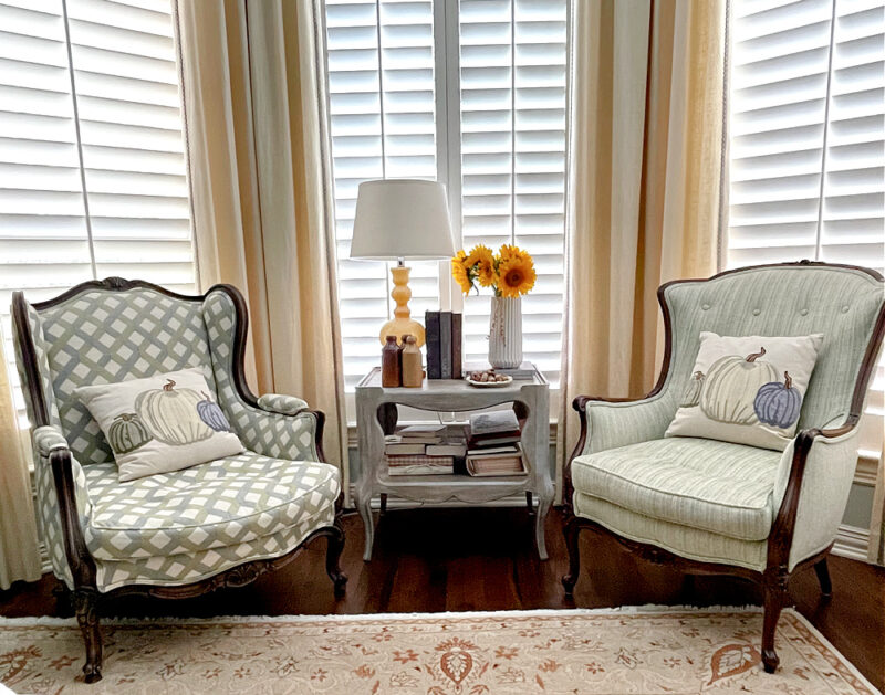 two wing chairs with fall accents