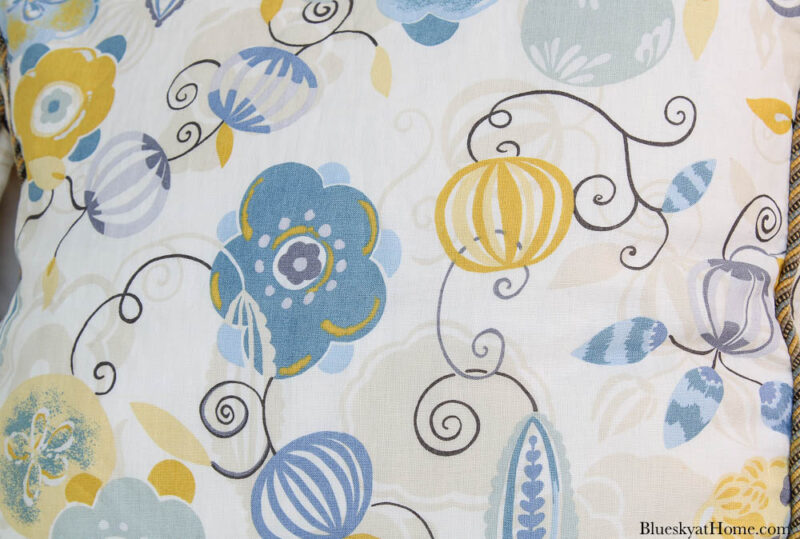 pillow in blue and gold abstract pattern