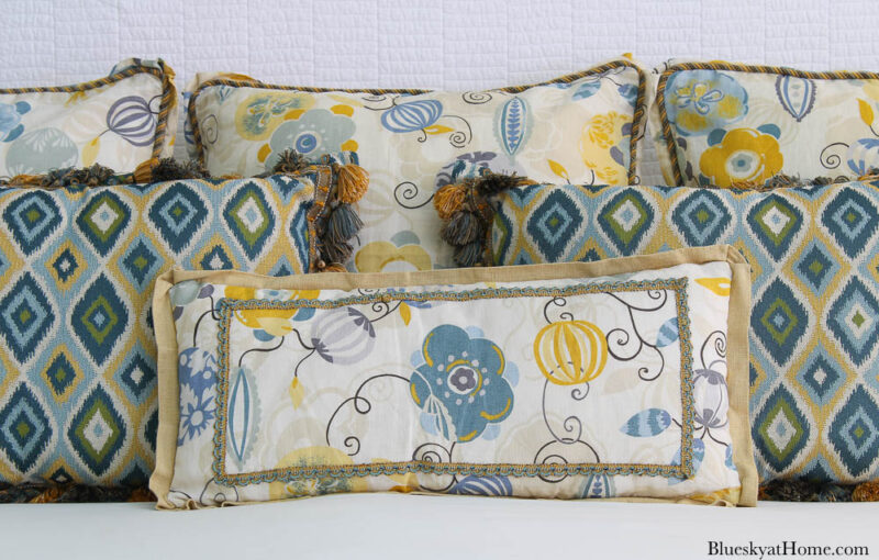 rectangle floral pillow on bed