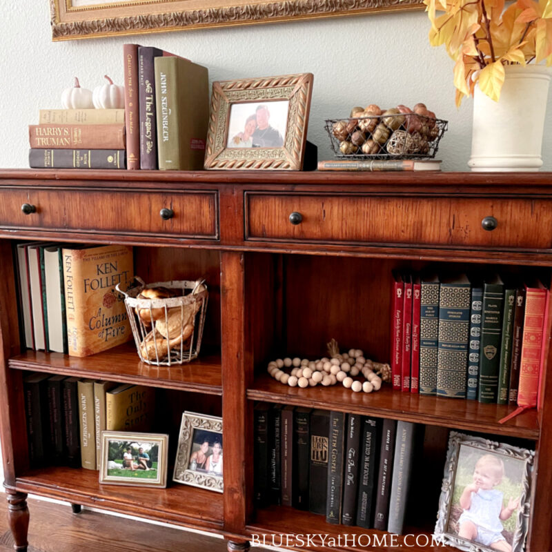 console table with fall accessories