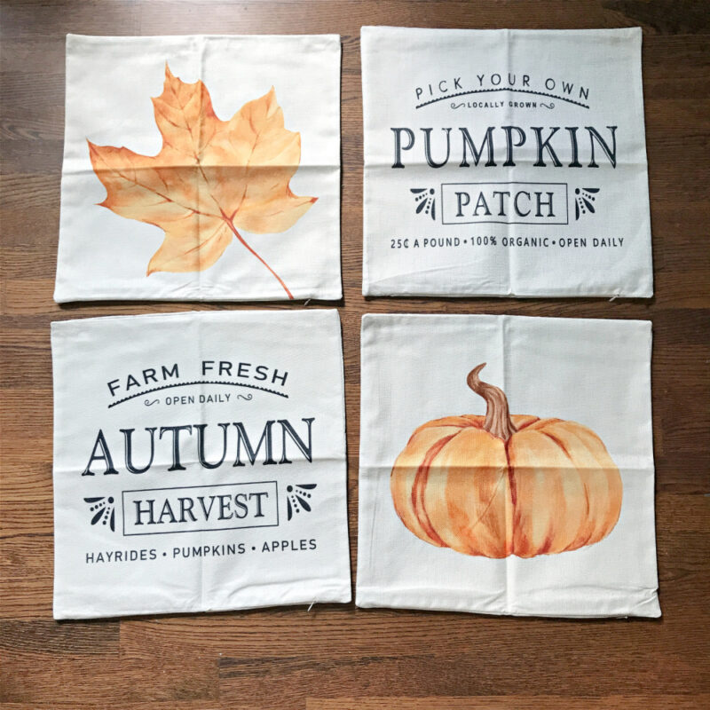 4 fall pillow covers with orange maple leaf, pumpkins, and graphics