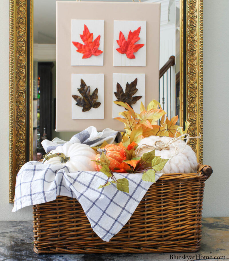 decorative pumpkin with yarn in basket and blue check dishtowels