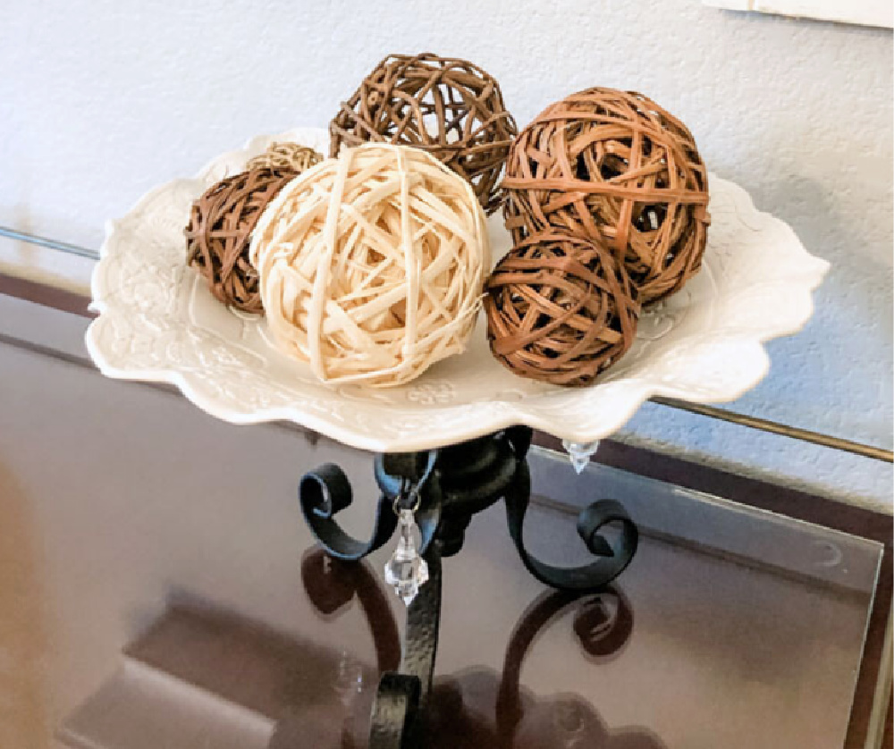 twig balls on a white cake stand