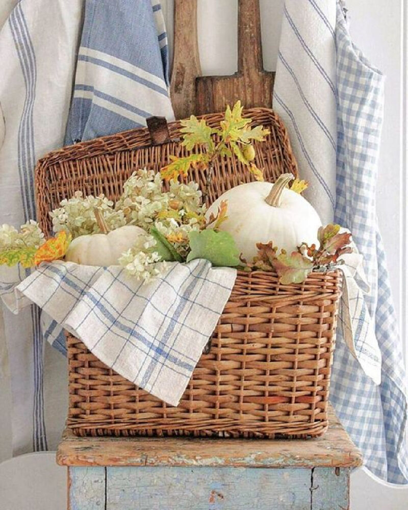 basket with white pumpkins and blue and white dish towels