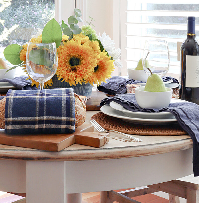 fall blue tablescape with sunflowers
