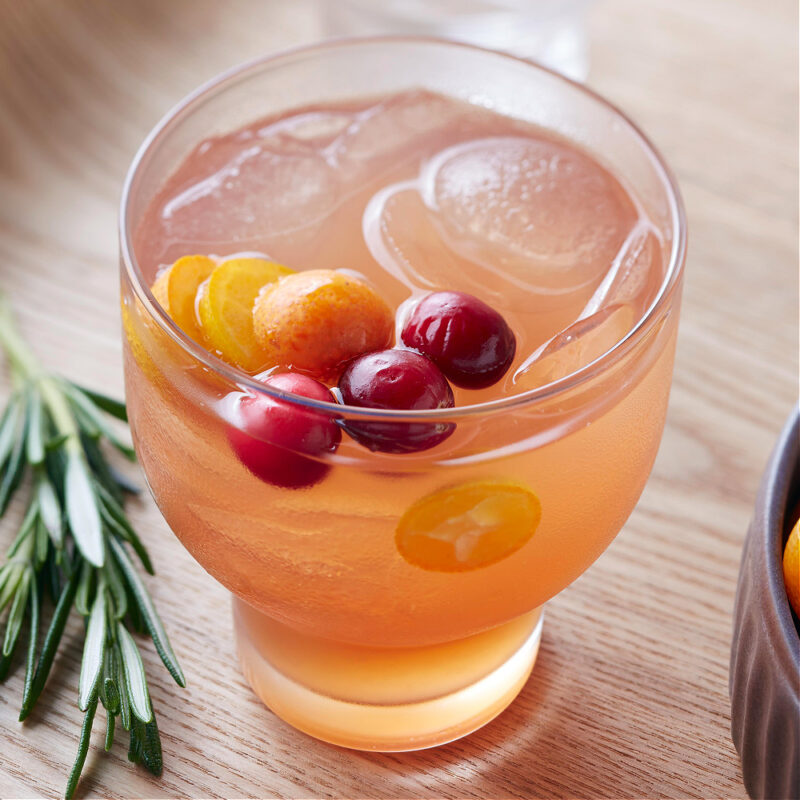 fall cocktail with cranberries and kumquat