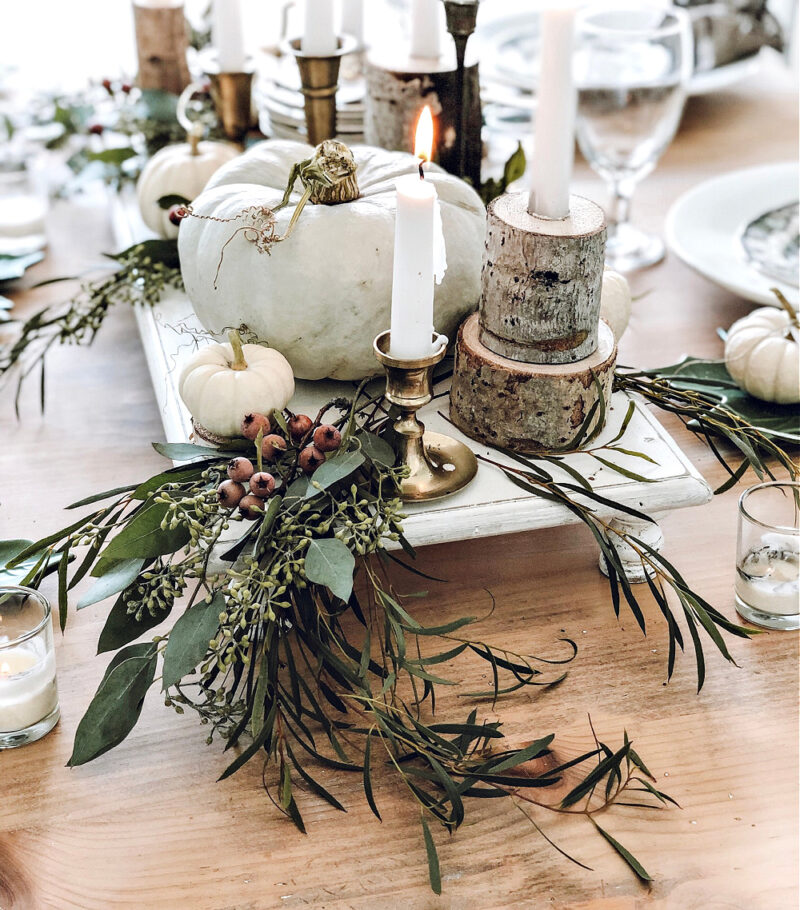 fall tablescape with white pumpkins and greenery