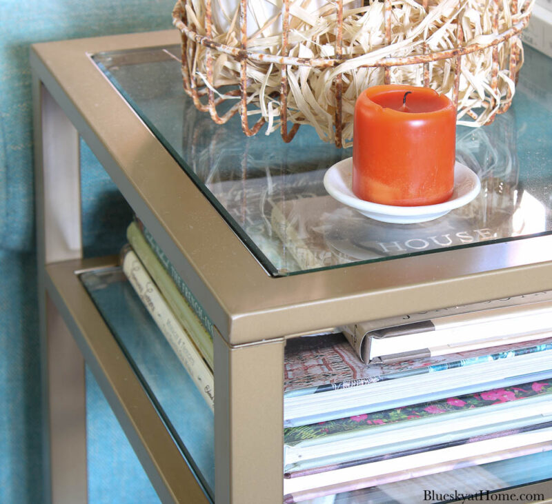 glass and metal end table with three shelves