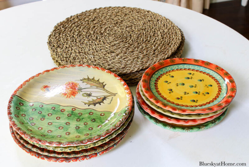 woven placemats and fall colored dinner and salad plates