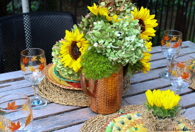 sunflowers and hydrangeas in copper pitcher