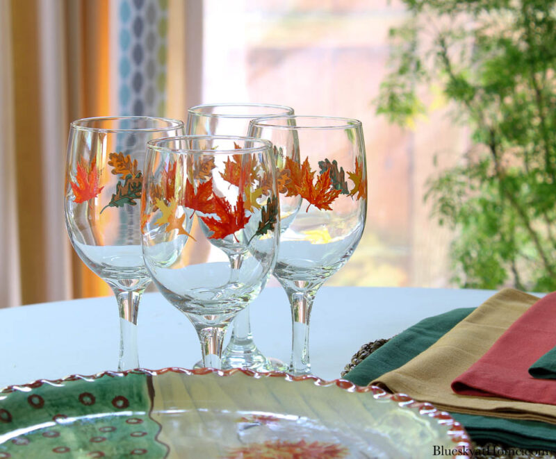 wine glasses with fall leaves