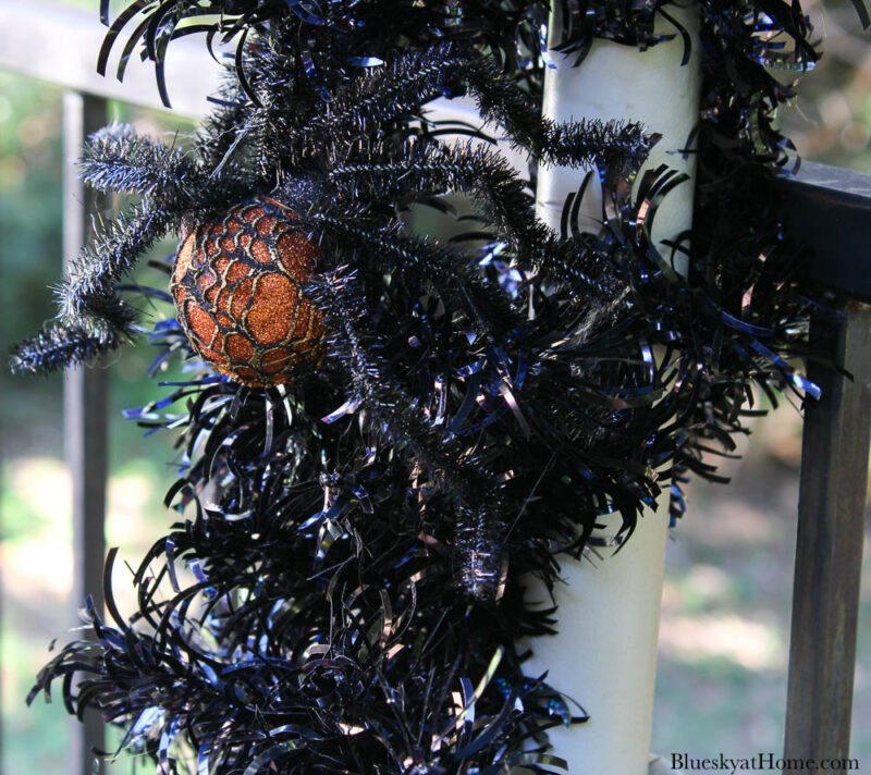 black garland on post with spider