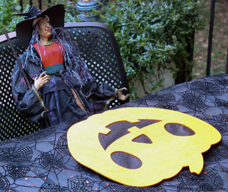 Halloween tablescape on the patio place setting with pumpkin placemat