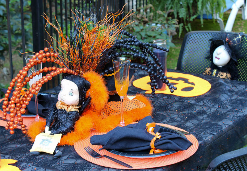 Halloween tablescape on the patio with witches