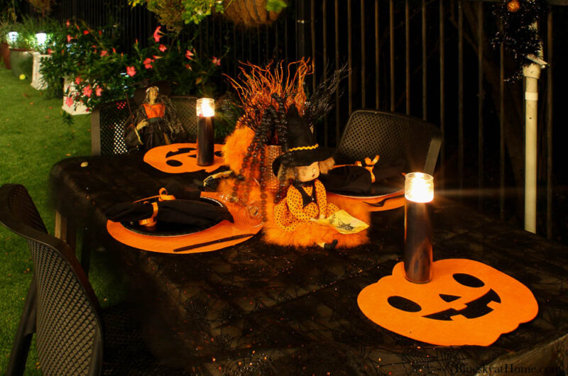 Halloween tablescape on the patio at night