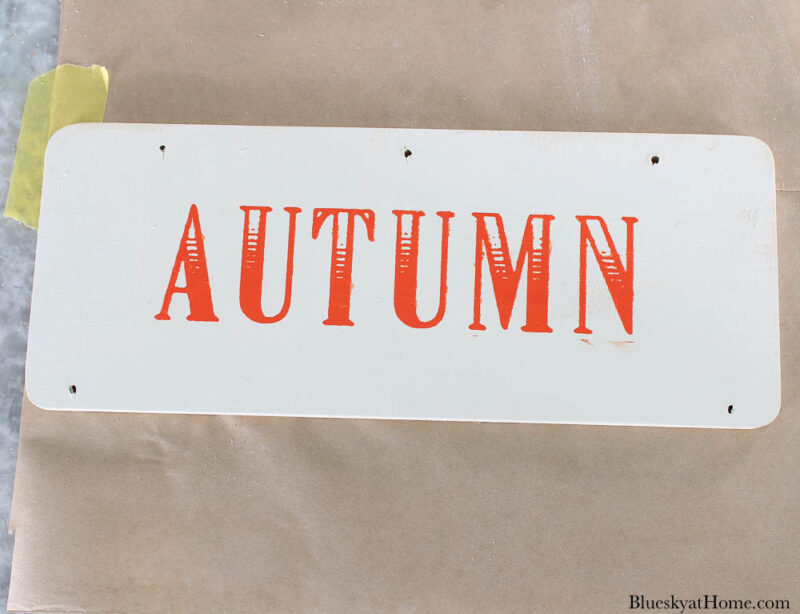wood sign with word autumn