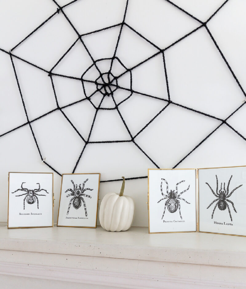 DIY spider web on wall above mantel